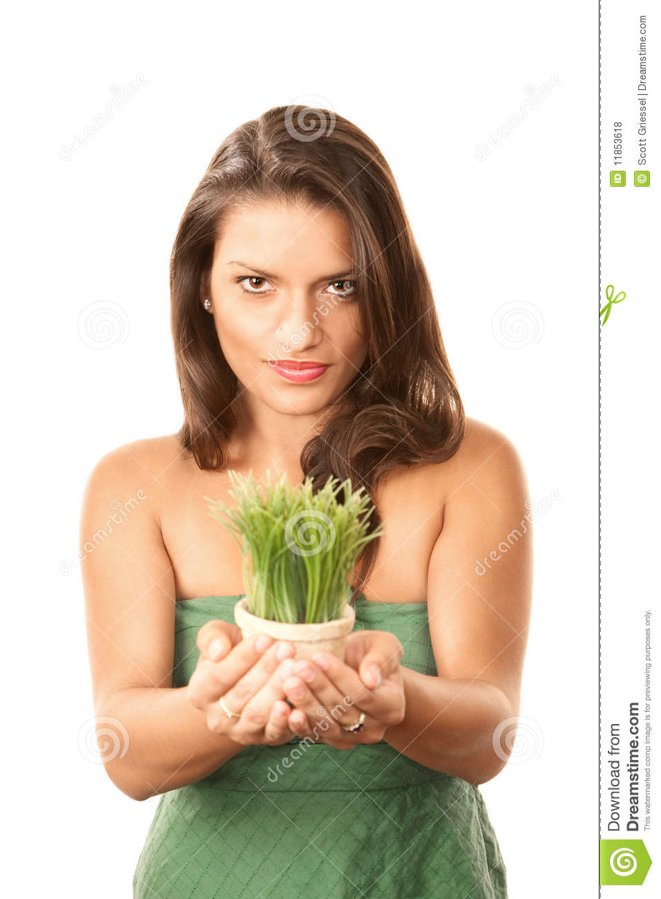 Pretty Hispanic Woman With Grass In Pot Royalty Free Stock
