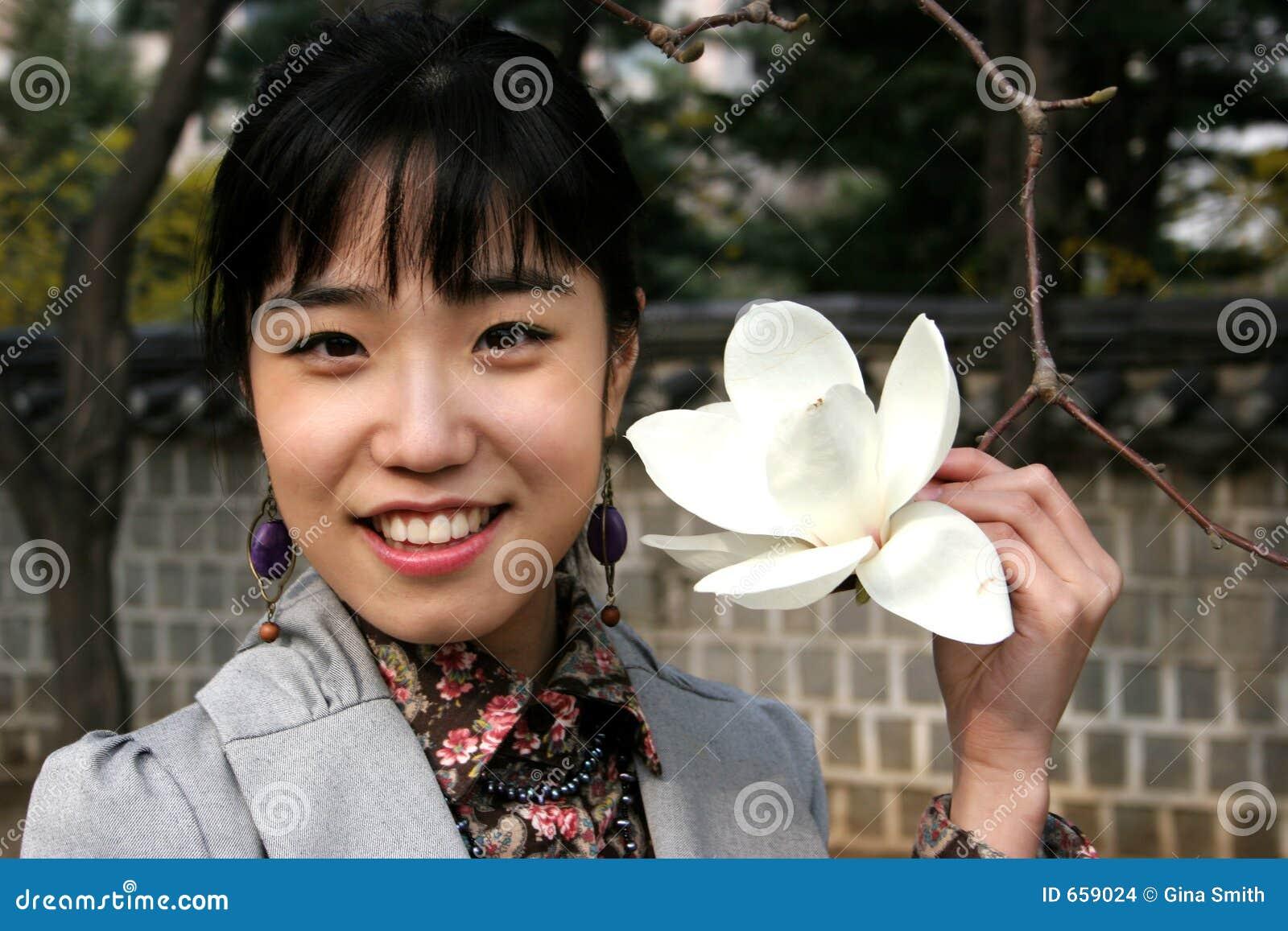 Pretty Korean woman holding a flower