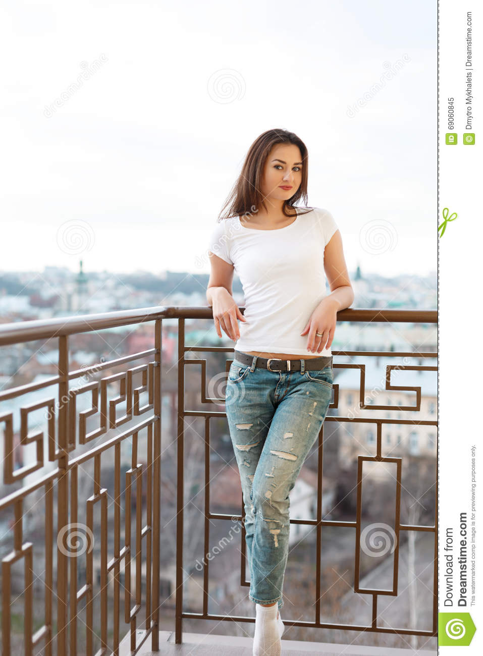 Pretty lady enjoying the weather and a photosession having for Balcony sessions