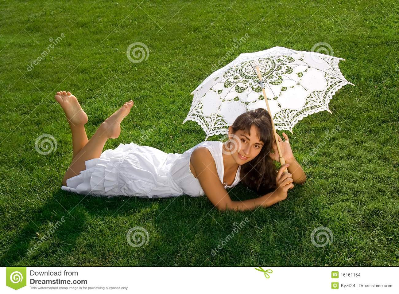 Pretty lady relaxing on the grass stock images image for Pretty grass
