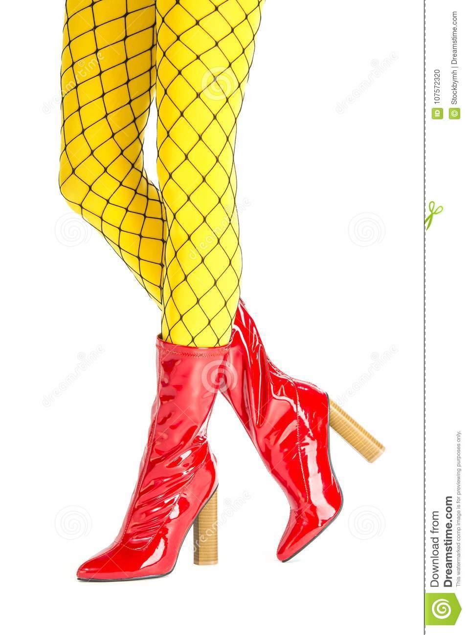 df574c2fd Pretty legs in fishnet stockings above yellow tights and high heels boots  made of red latex