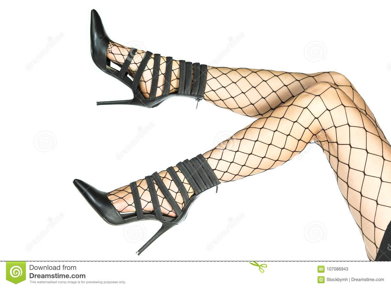 39fd15689 Pretty legs in fishnet stockings and stiletto high heels isolated on white  background.
