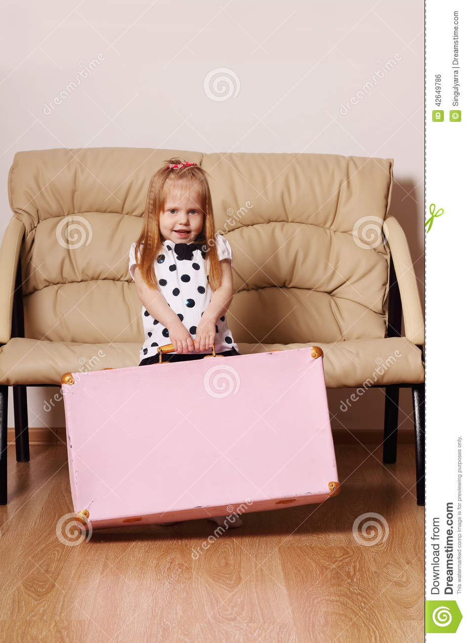 Pretty Little Blonde Girl Drags Big Pink Suitcase Near Sofa Stock ...