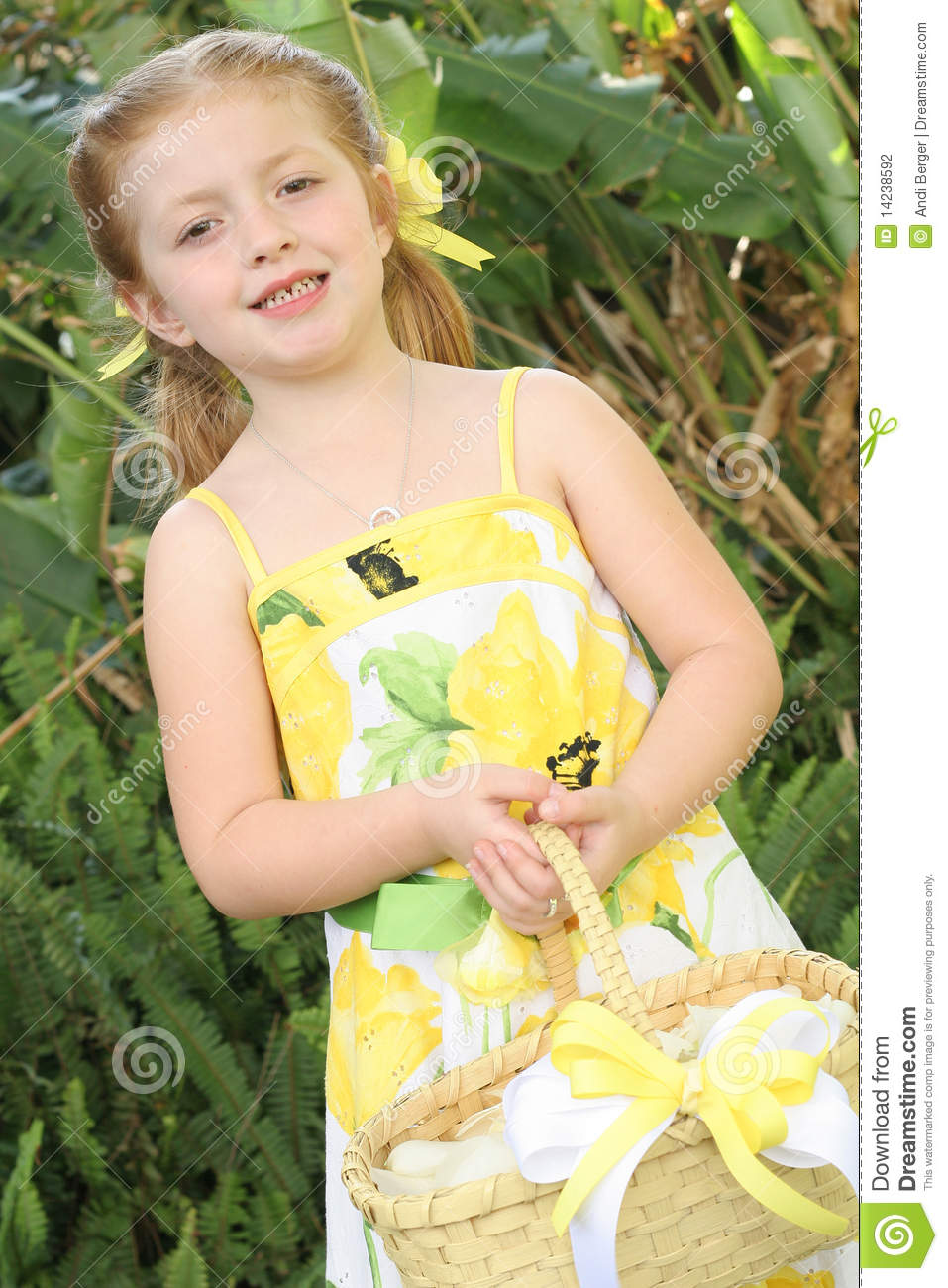 Pretty Little Flower Girl Holding Basket Of Petals Stock Photo