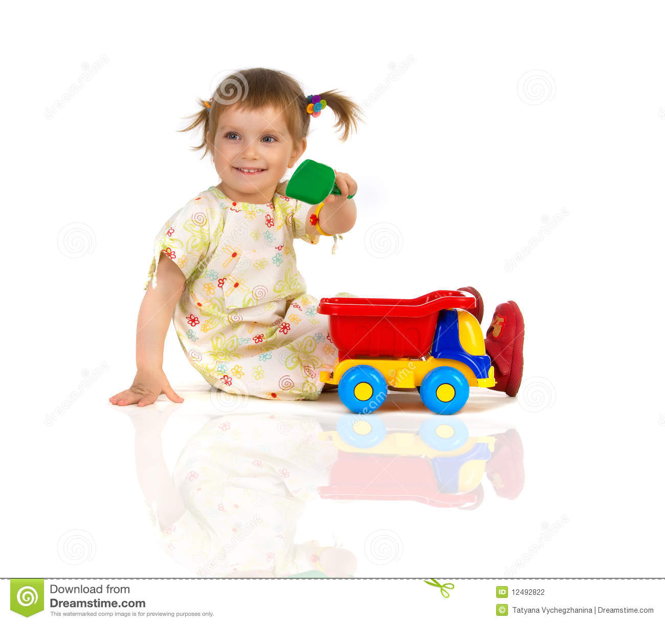 Little Girl Toys : Pretty little girl and her toys stock photography image