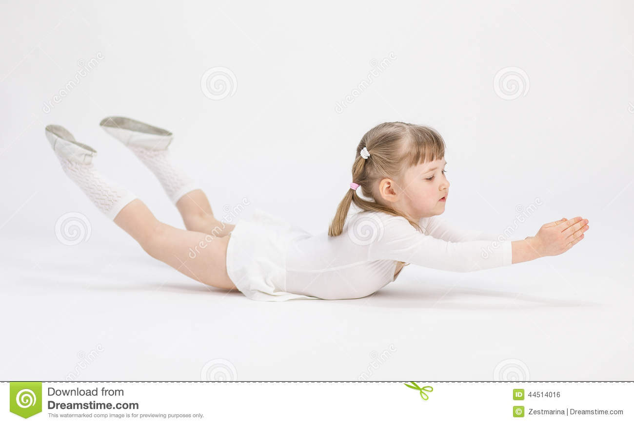 Pretty Little Girl Lying On The Floor And Doing Exercise
