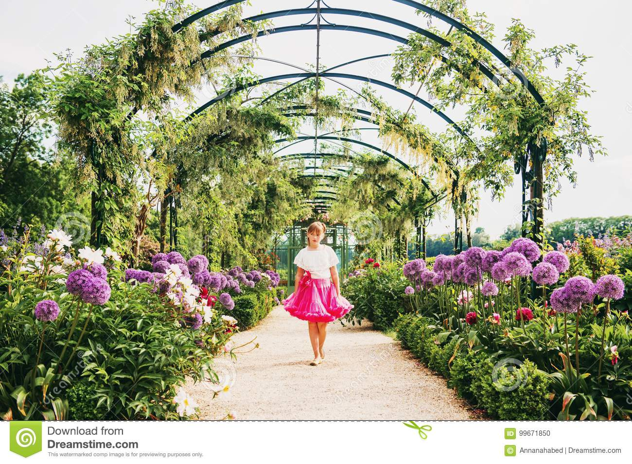 Pretty Little Girl Playing In A Beautiful Garden Stock Photo Image
