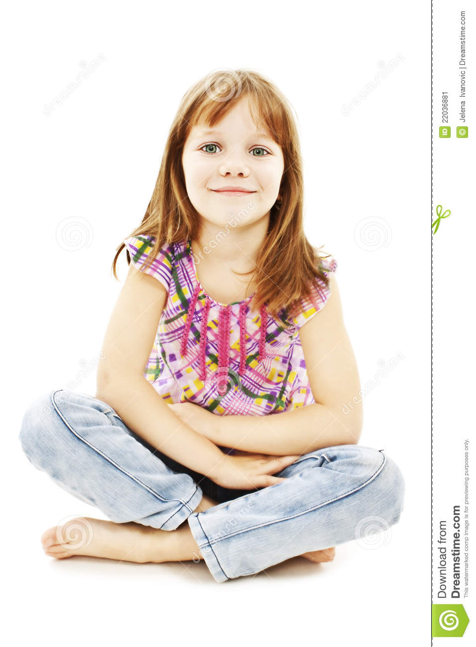 Pretty Little Girl Sitting On The Floor In Jeans Stock