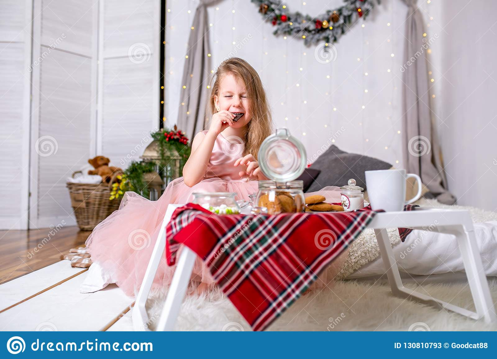 Pretty Little Girl 4 Years Old In A Pink Dress Child The Christmas Room With Bed Eating Candy Chocolate Cookies And Drink Stock Image Of 130810793