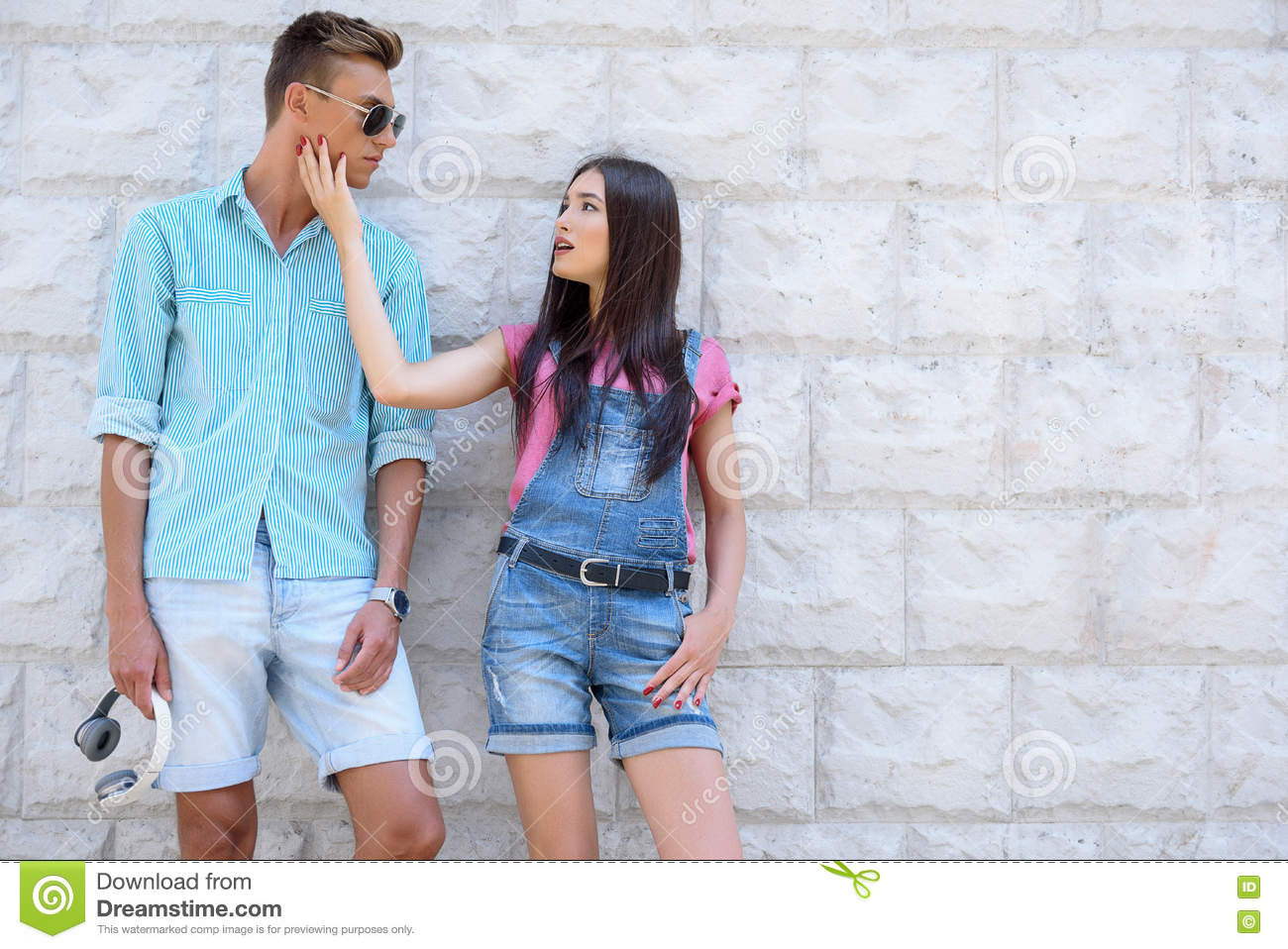 Pretty loving couple dating outdoors