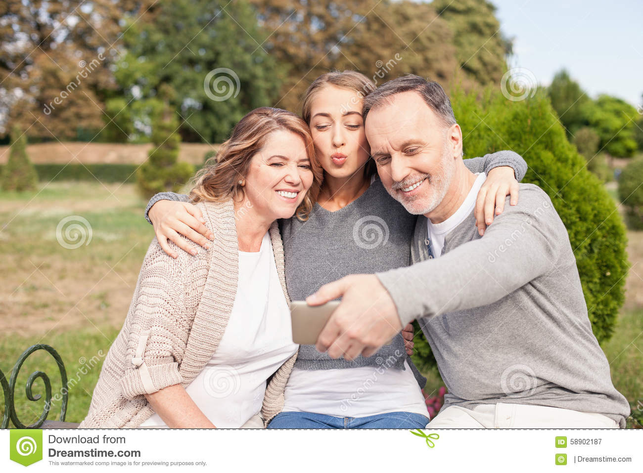 Pretty mature family is photographing themselves