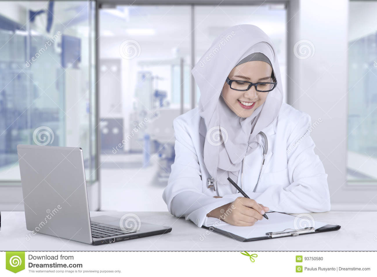Pretty Muslim Doctor Working In Clinic Stock Photo Image Of