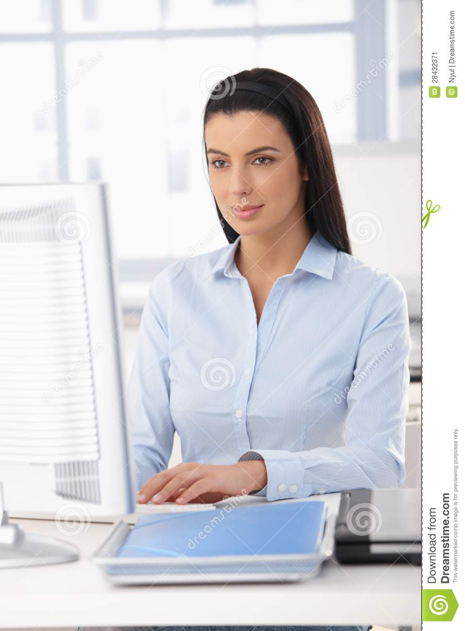 Office Worker At A Desk Royalty Free Stock Photo