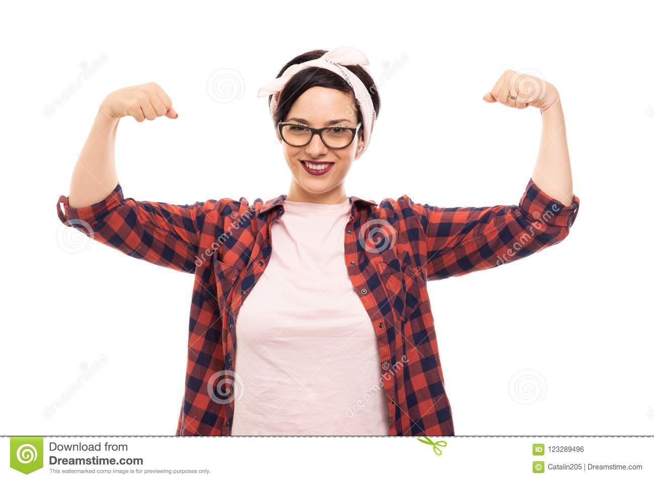 Pretty pin-up girl wearing glasses showing both her biceps