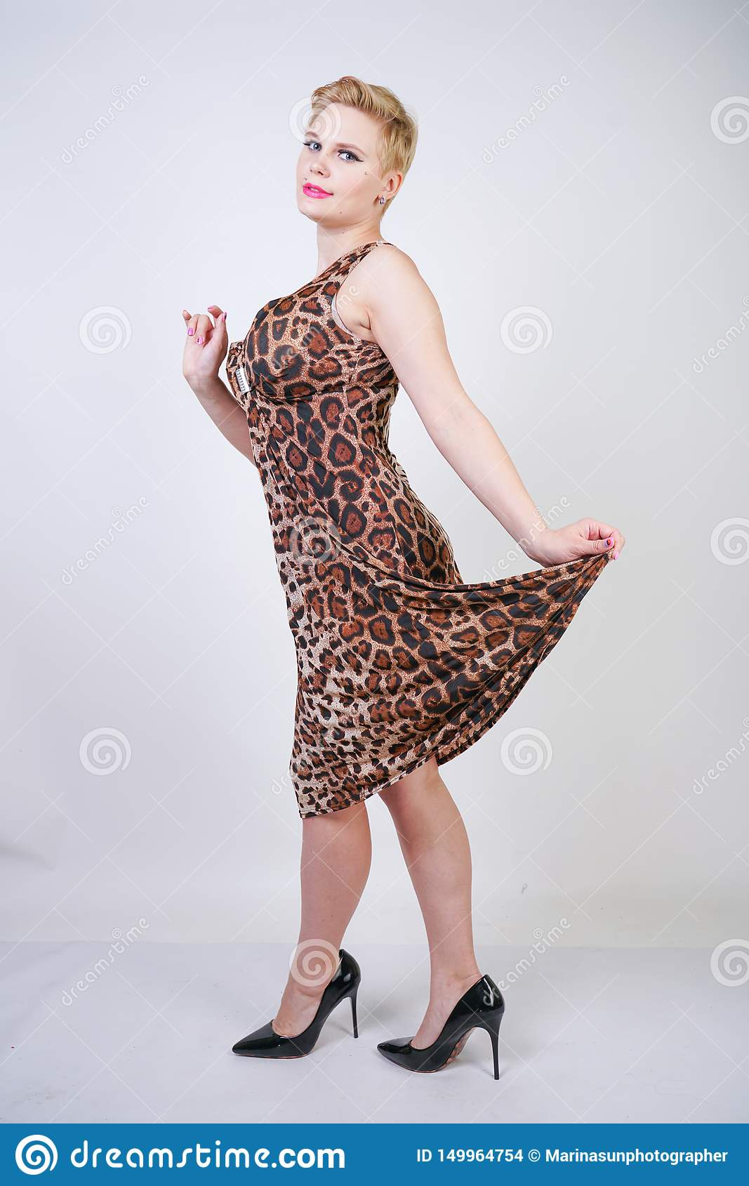 Pretty Plus Size Young Woman With Short Blonde Hair Wearing ...