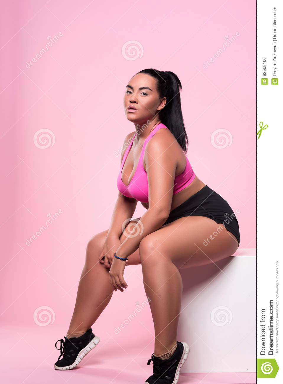 pretty posing sitting chubby lady stock photo - image of background
