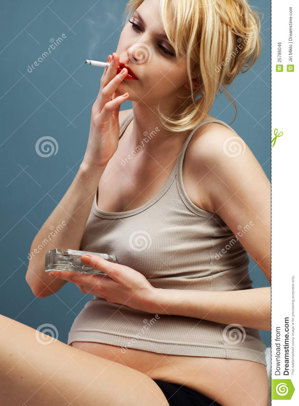 http://thumbs.dreamstime.com/z/pretty-pregnant-cigarette-ashtray-25786046.jpg