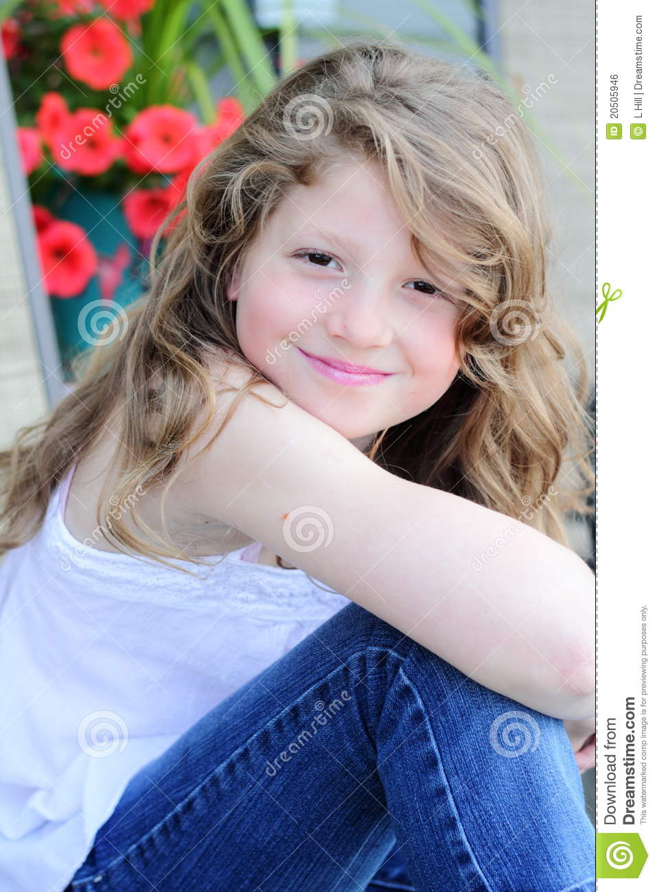 Pretty preteen girl with long blond hair, shallow depth of field.