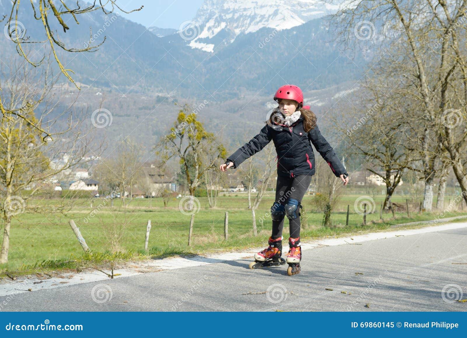 Black woman on roller skates riding outdoors on urban