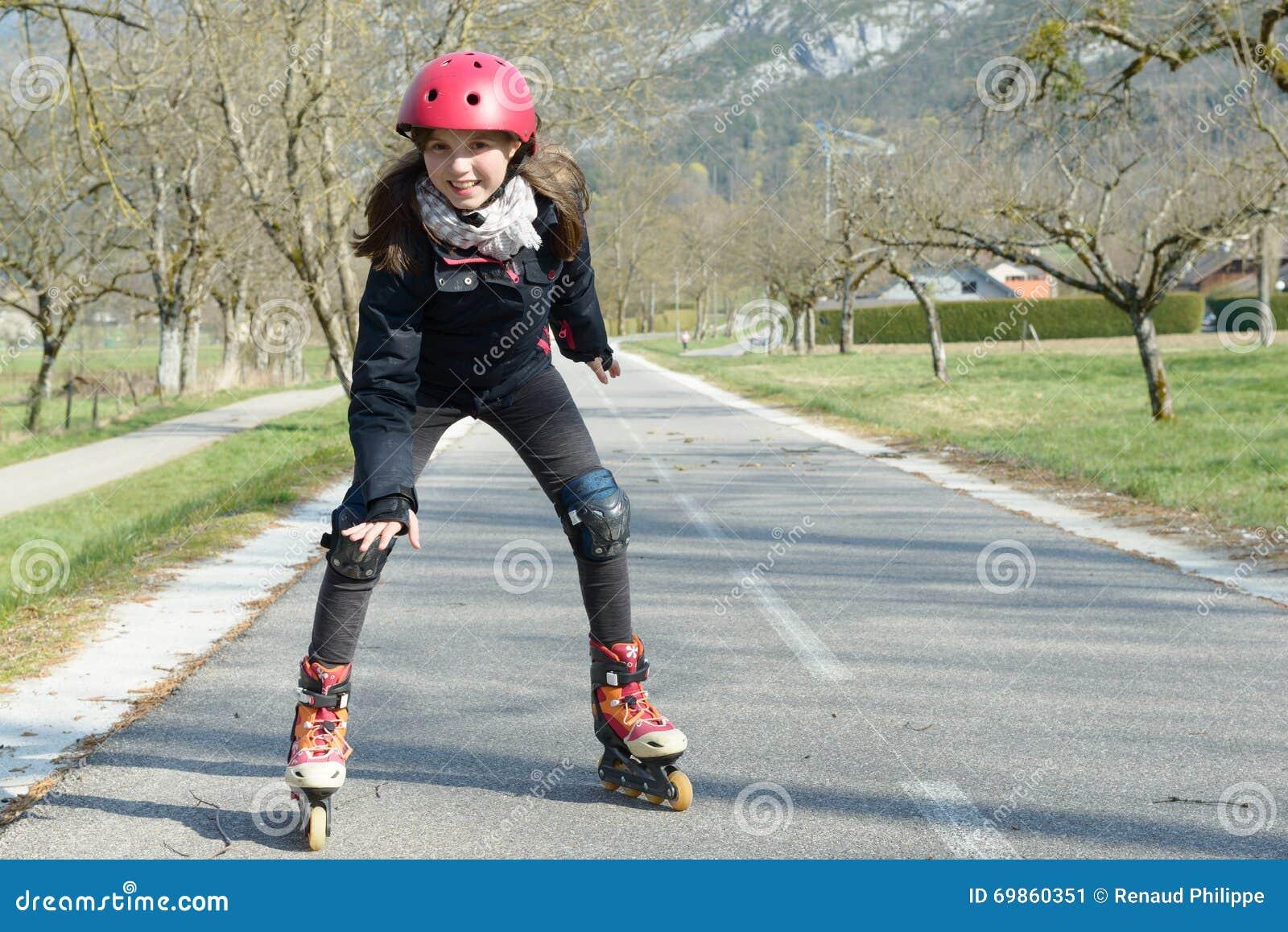 Roller skates helmet - Pretty Preteen Girl On Roller Skates In Helmet At A Track