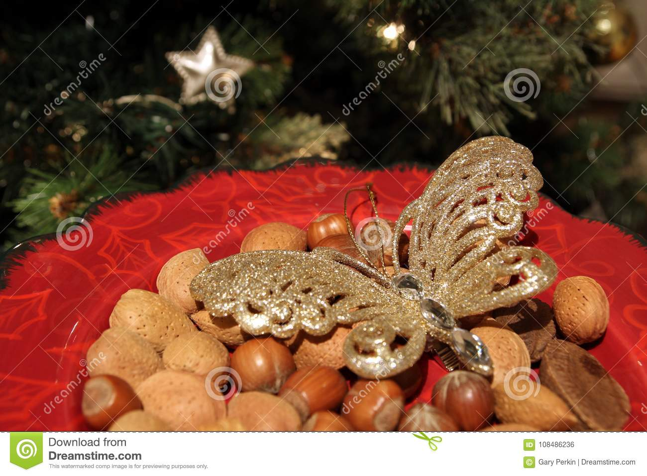 Brazil Christmas Traditions.Pretty Red Christmas Plate With Traditional Festive Almonds