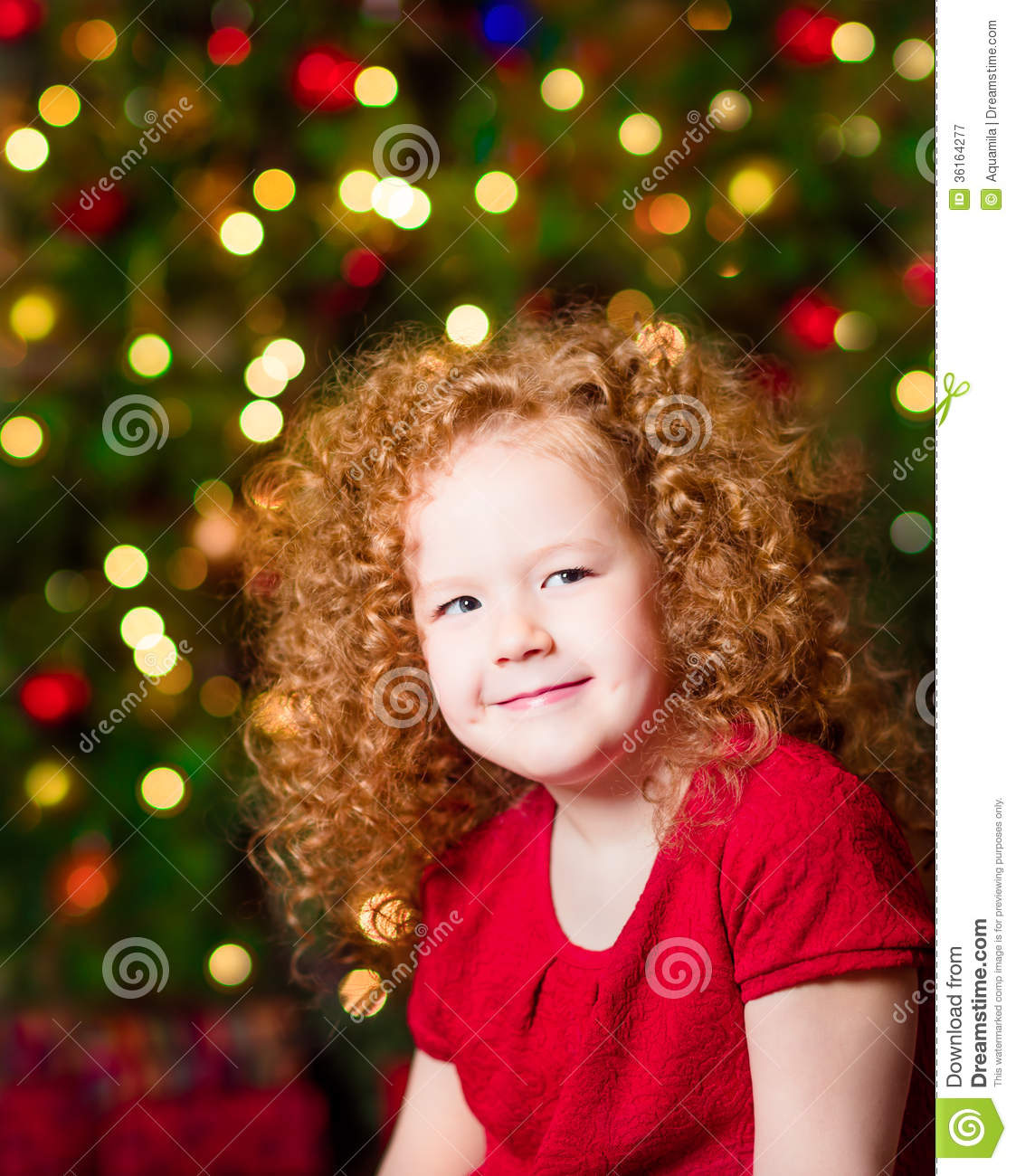 Little Girl Christmas Tree: Pretty Red-haired Little Girl Wearing Red Dress Sitting In
