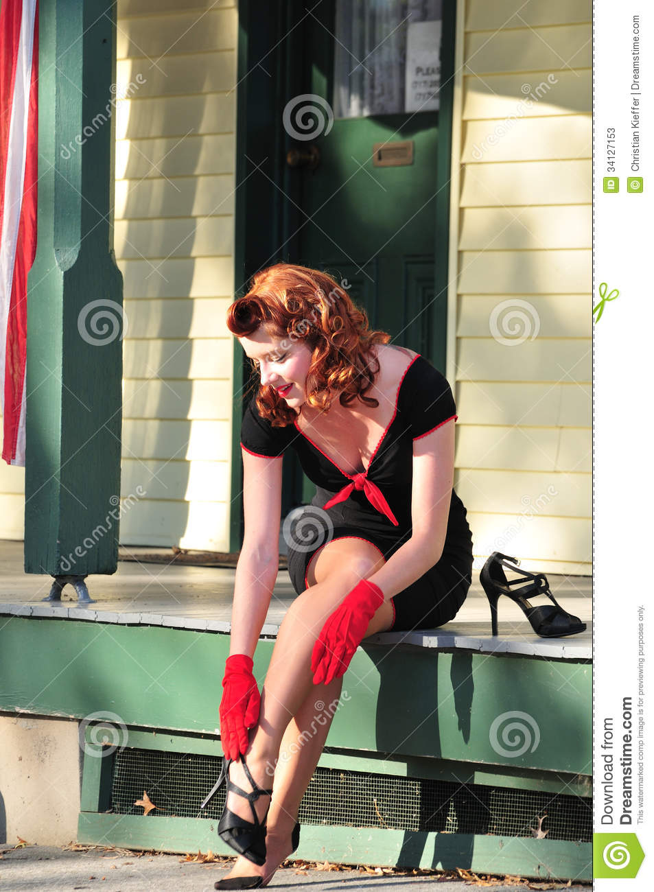 Pretty Redhead Putting On Her Heels Stock Photos - Image ...