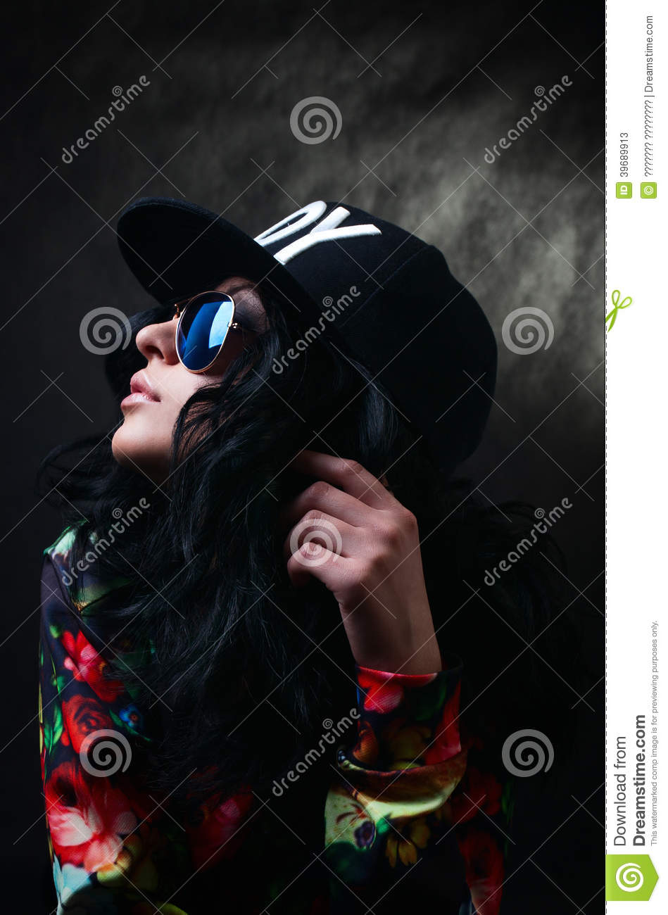 Pretty Brunette In A Black Cap And Glasses. Swag Girl. Fash