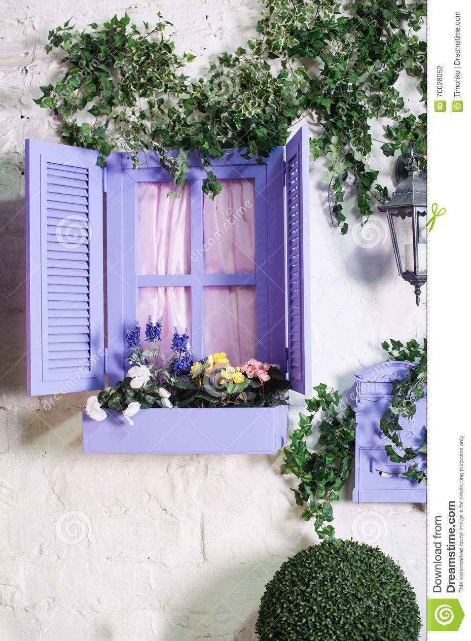 Pretty Small Purple Window And Box With Flowers In An Old House