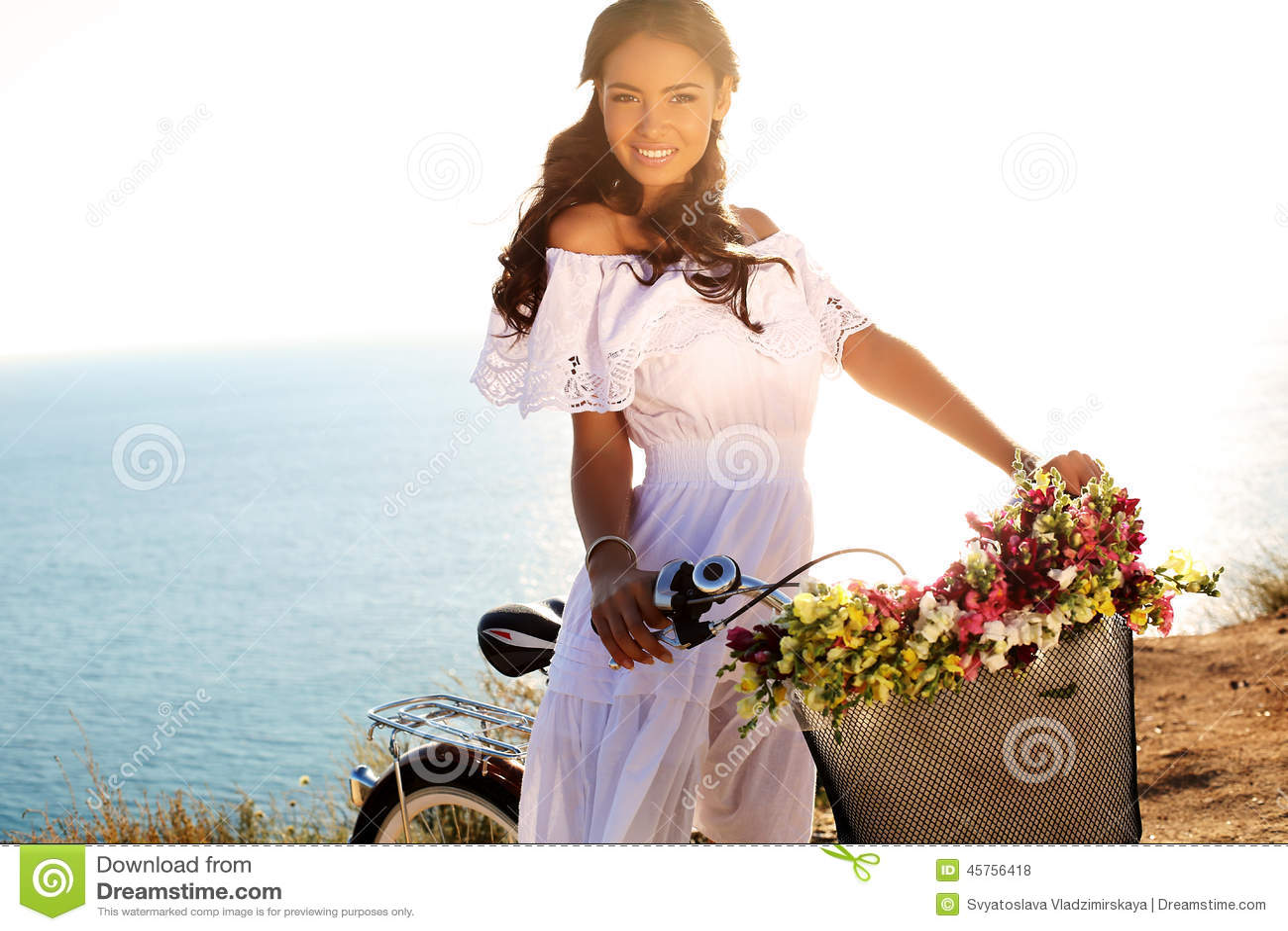Pretty Smiling Girl With Dark Hair In Elegant Dress