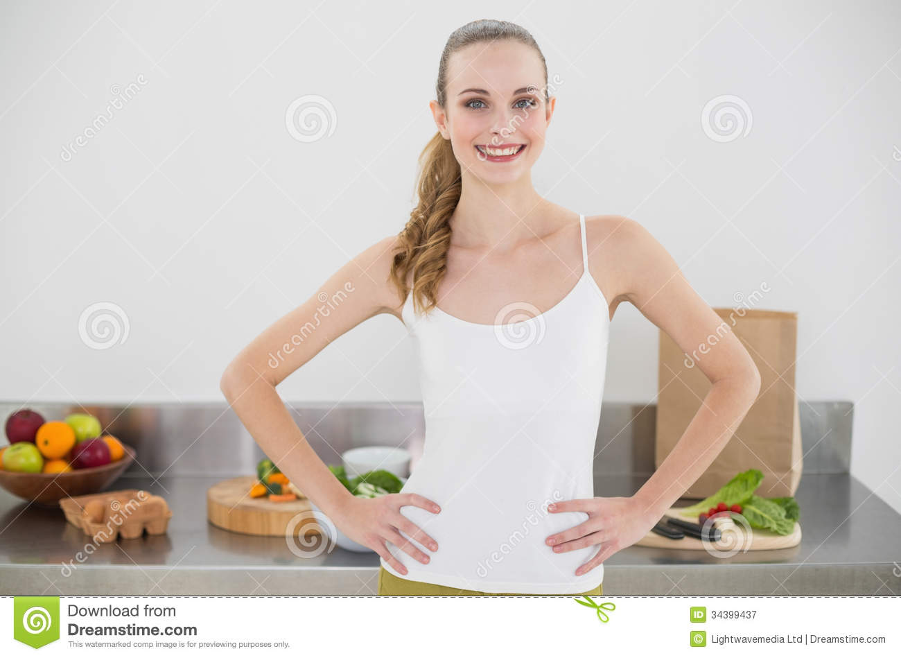 Pretty Smiling Woman Standing Hands On Hips Royalty Free ...