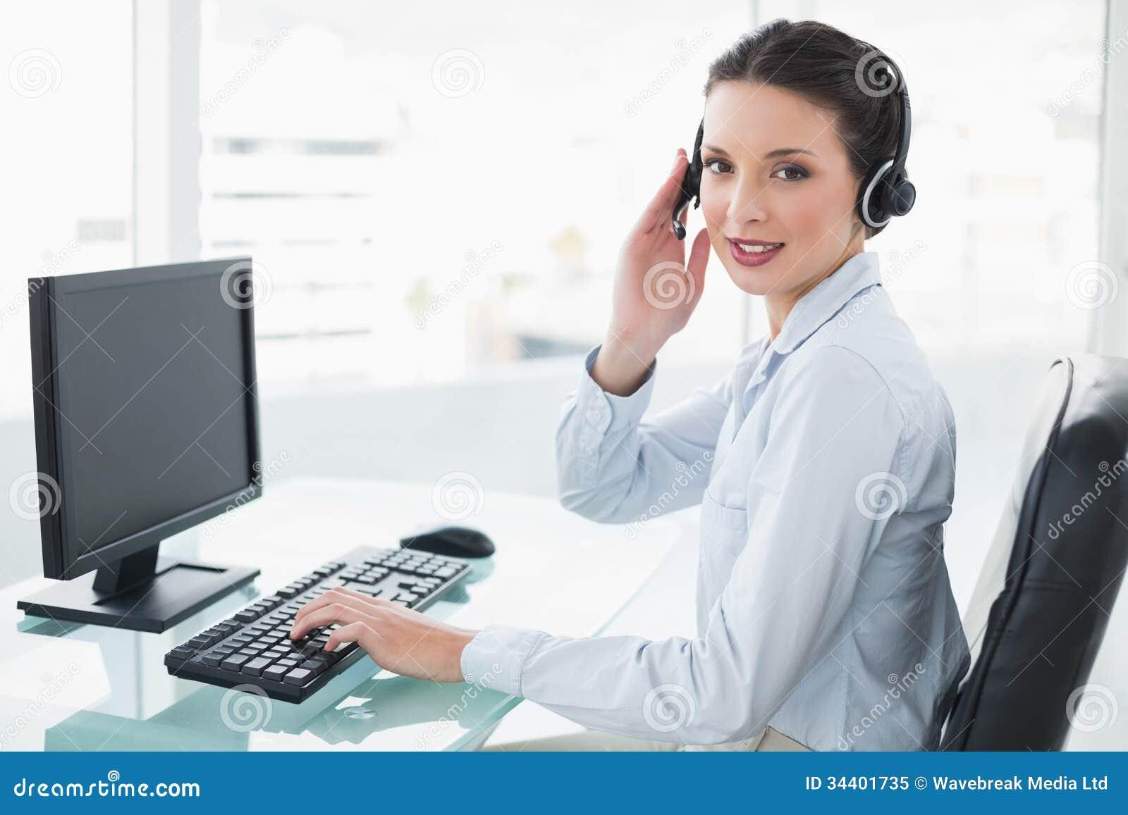 pretty stylish brunette operator using a computer and