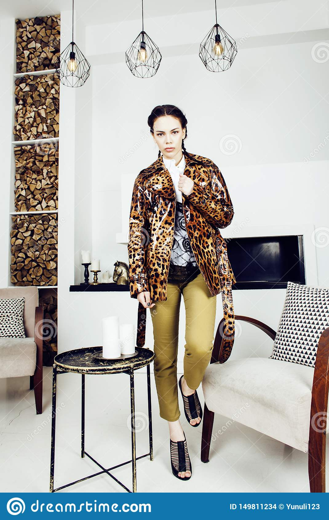 Pretty stylish woman in fashion dress with leopard print in luxury house interior, lifestyle people concept