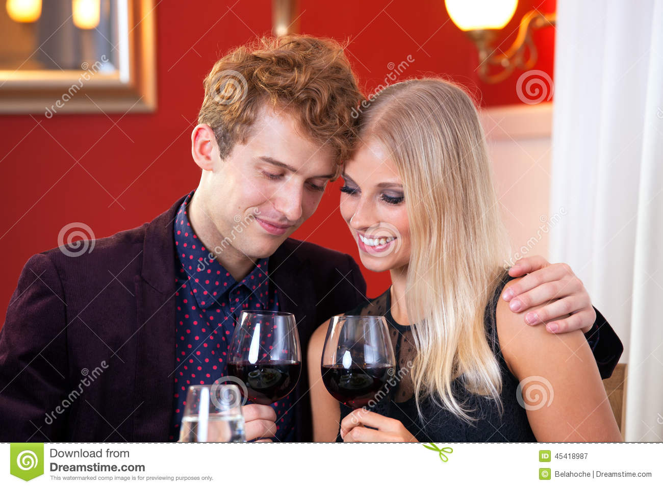 Pretty Sweet Lovers Holding Glass of Wines.