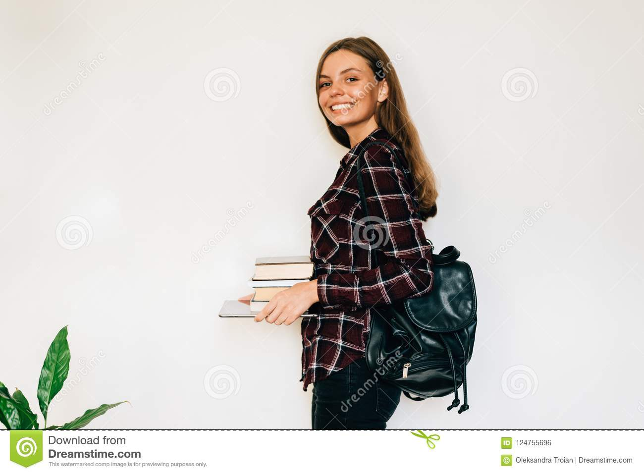 Pretty teen gild student of school or college with stack of books education