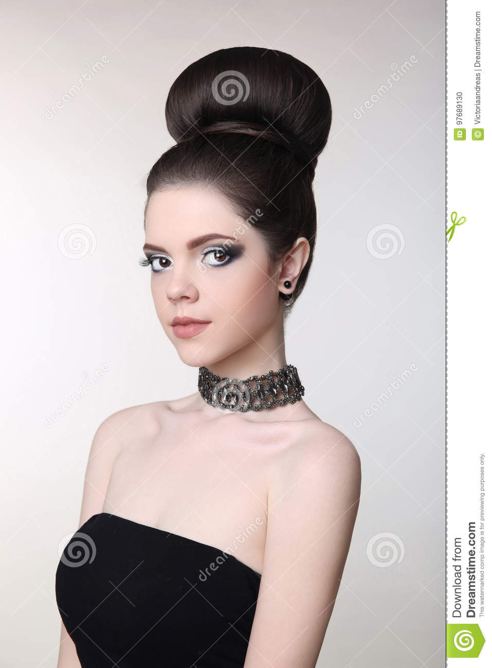 Pretty Teen Girl With Cute Bun Hairstyles, Bright Makeup ...