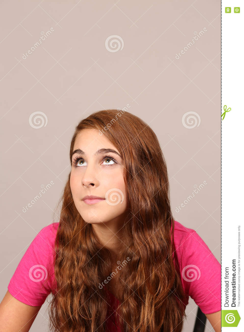 Pretty Teen Girl Looking Up Stock Photo