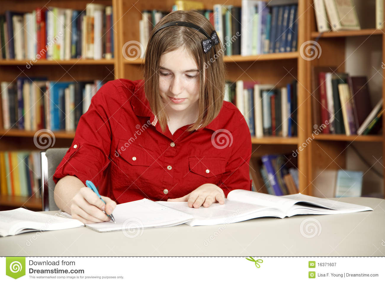 Pretty Teen In Library stock image