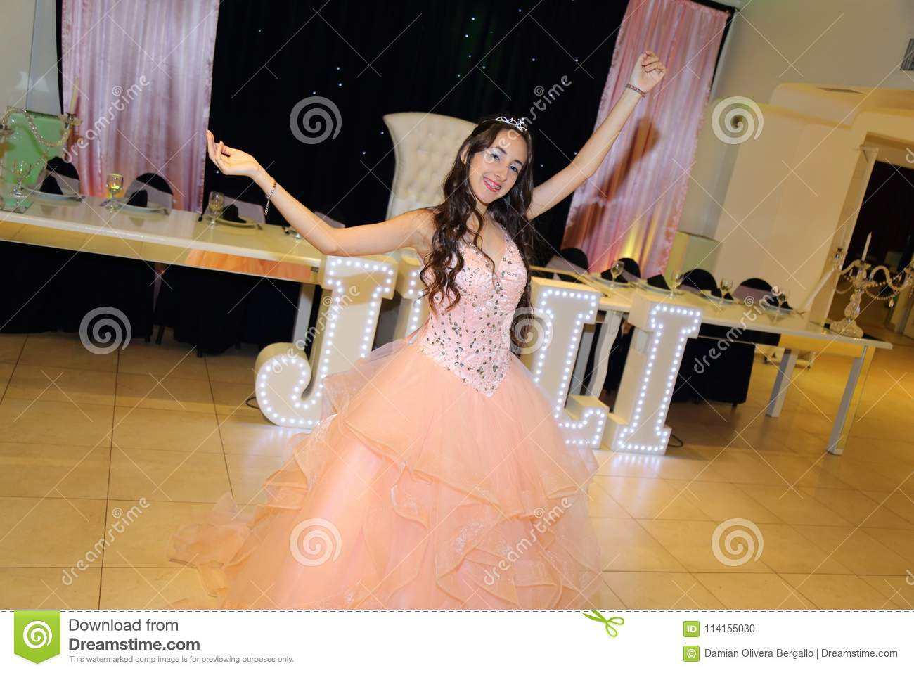Pretty teen quinceanera birthday girl celebrating in princess dress pink party, special celebration of girl becoming woman.