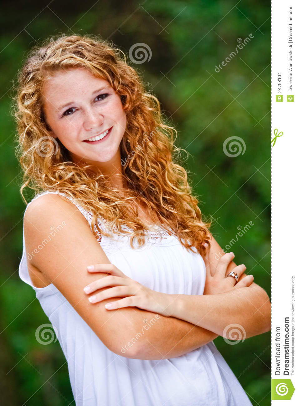 Pretty Teenage Girl Curly Hair Arms Crossed Stock Images
