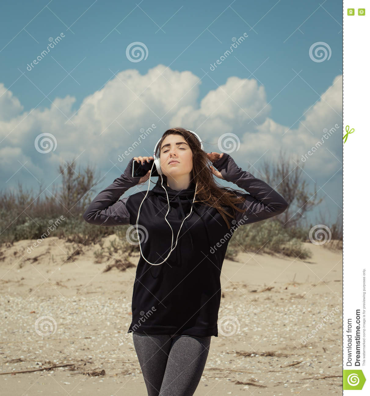 Pretty teenage girl with headphones listening to music