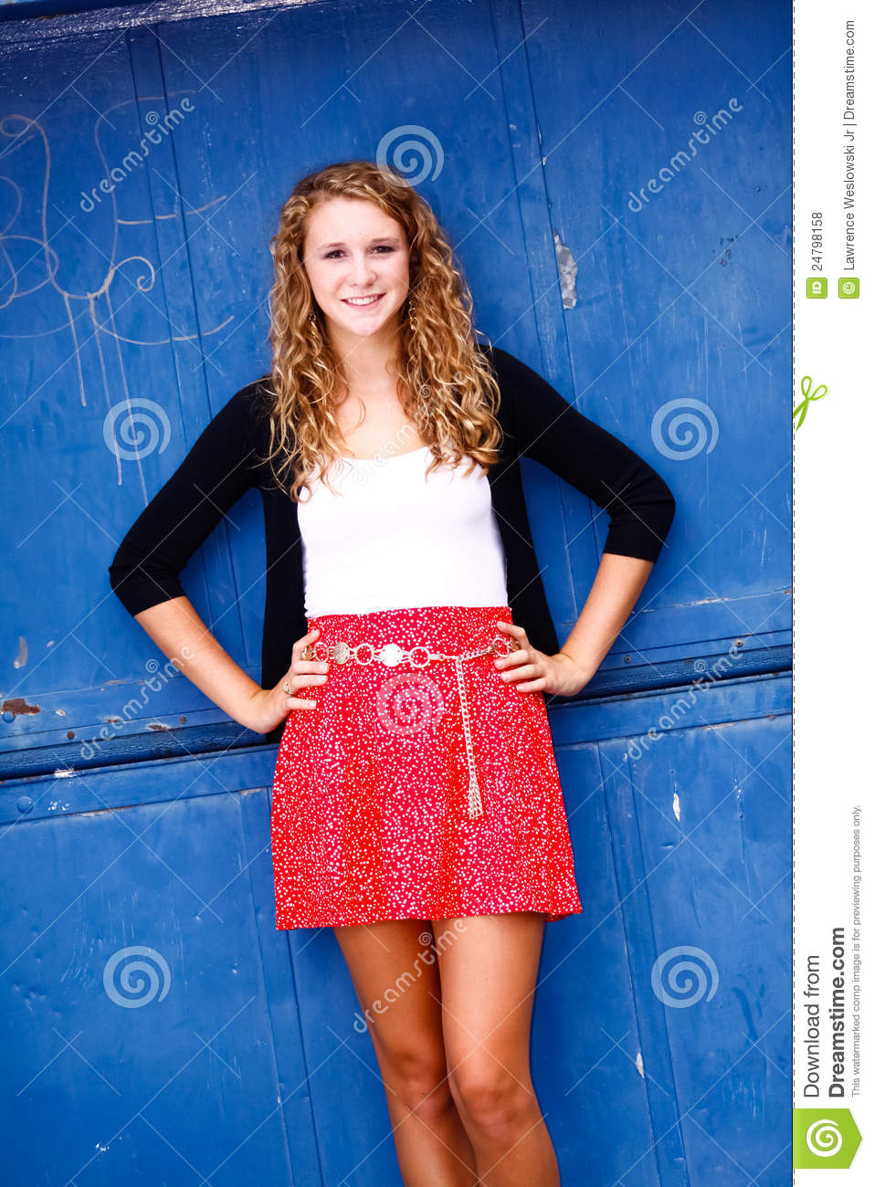 Pretty teenage girl standing hands on hips royalty free stock photos
