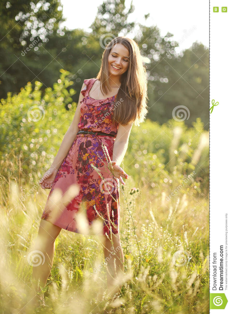 Pretty teenage girl in the summer park
