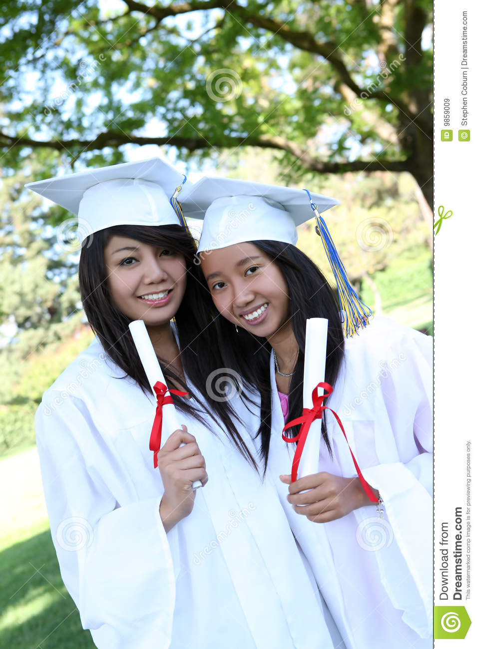 pretty teens at graduation royalty free stock images