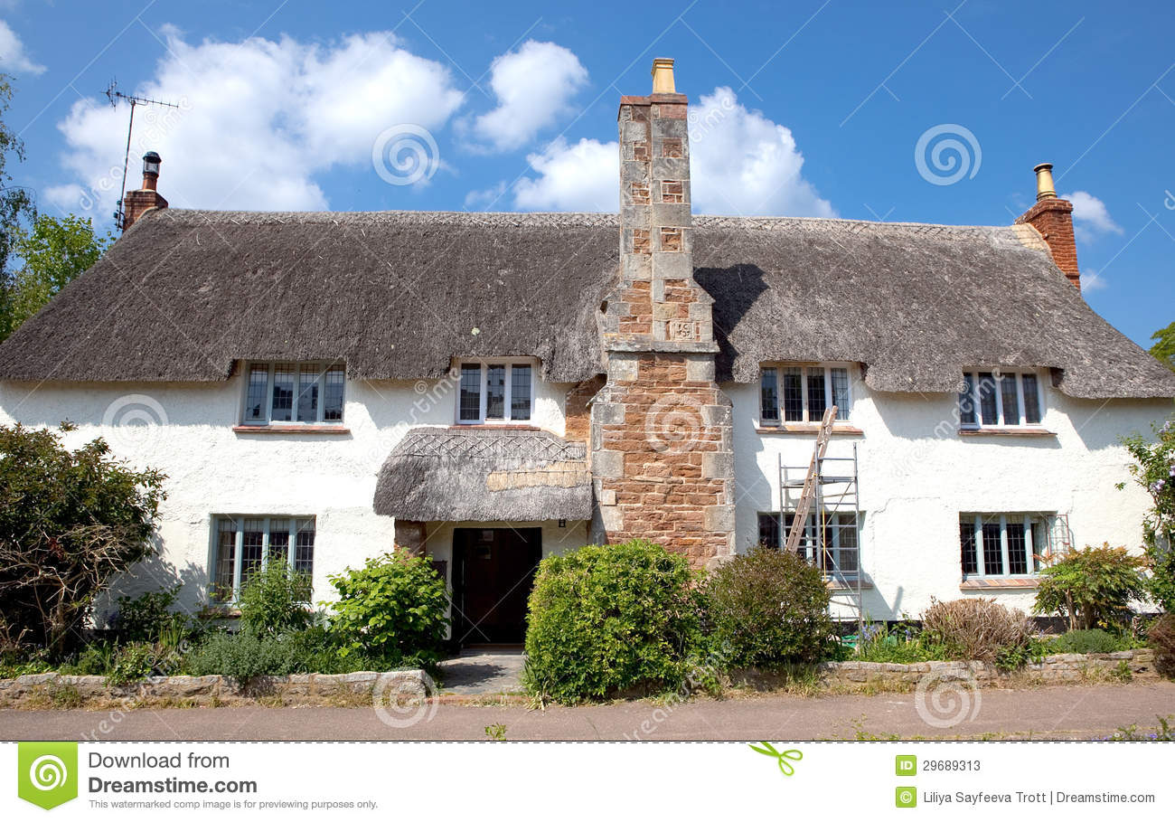 A Pretty Thatched Cottage In Otterton, Devon, UK Stock ...
