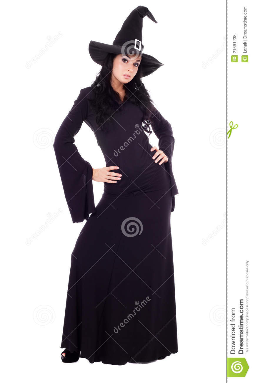 Pretty young brunette witch, isolated against white background.