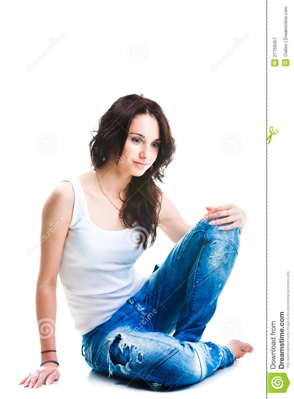 Pretty Woman In Blue Jeans Sitting On White Floor Stock ...