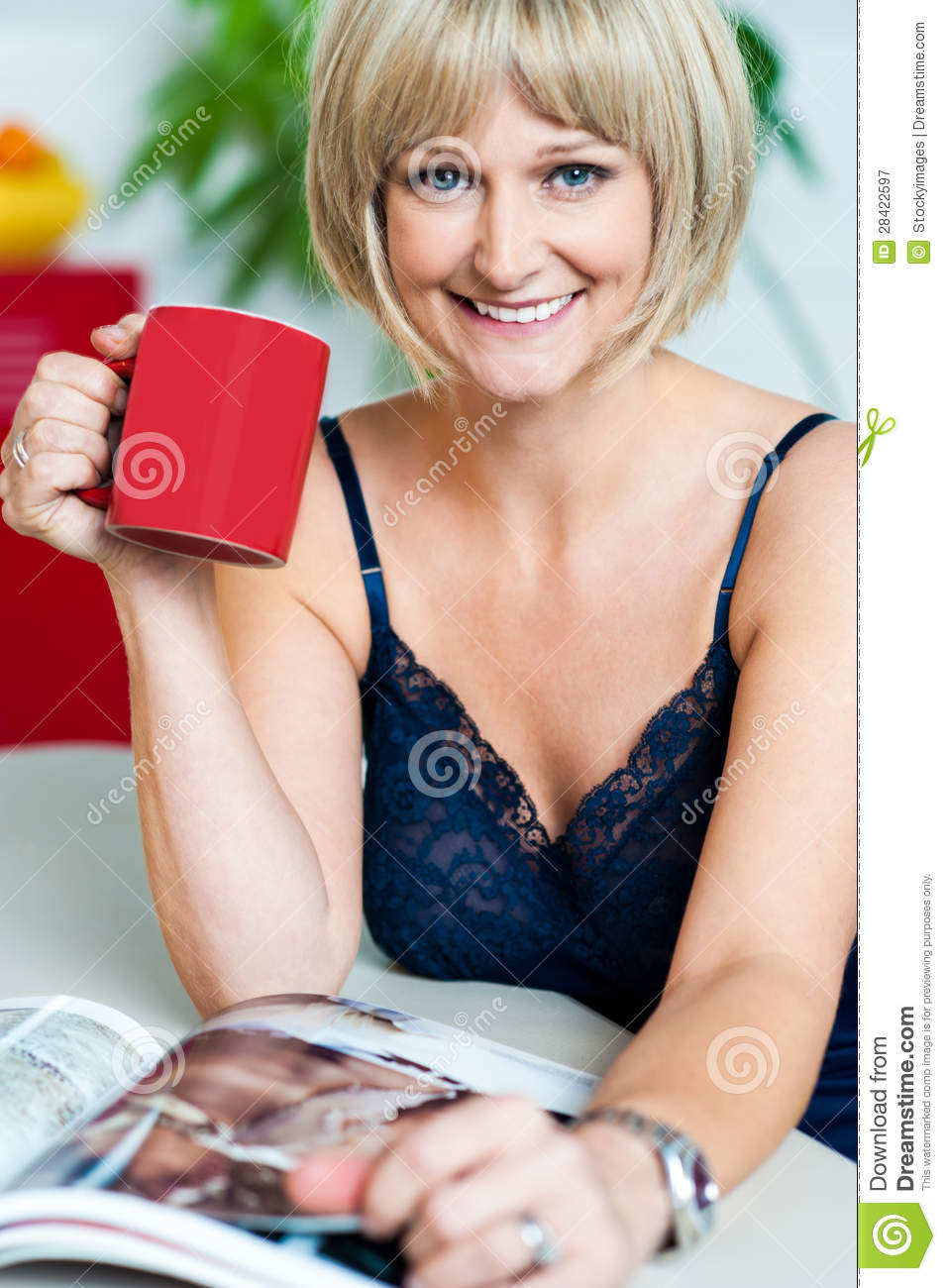 pretty woman with a coffee mug in hand reading magazine royalty free stock photography image. Black Bedroom Furniture Sets. Home Design Ideas