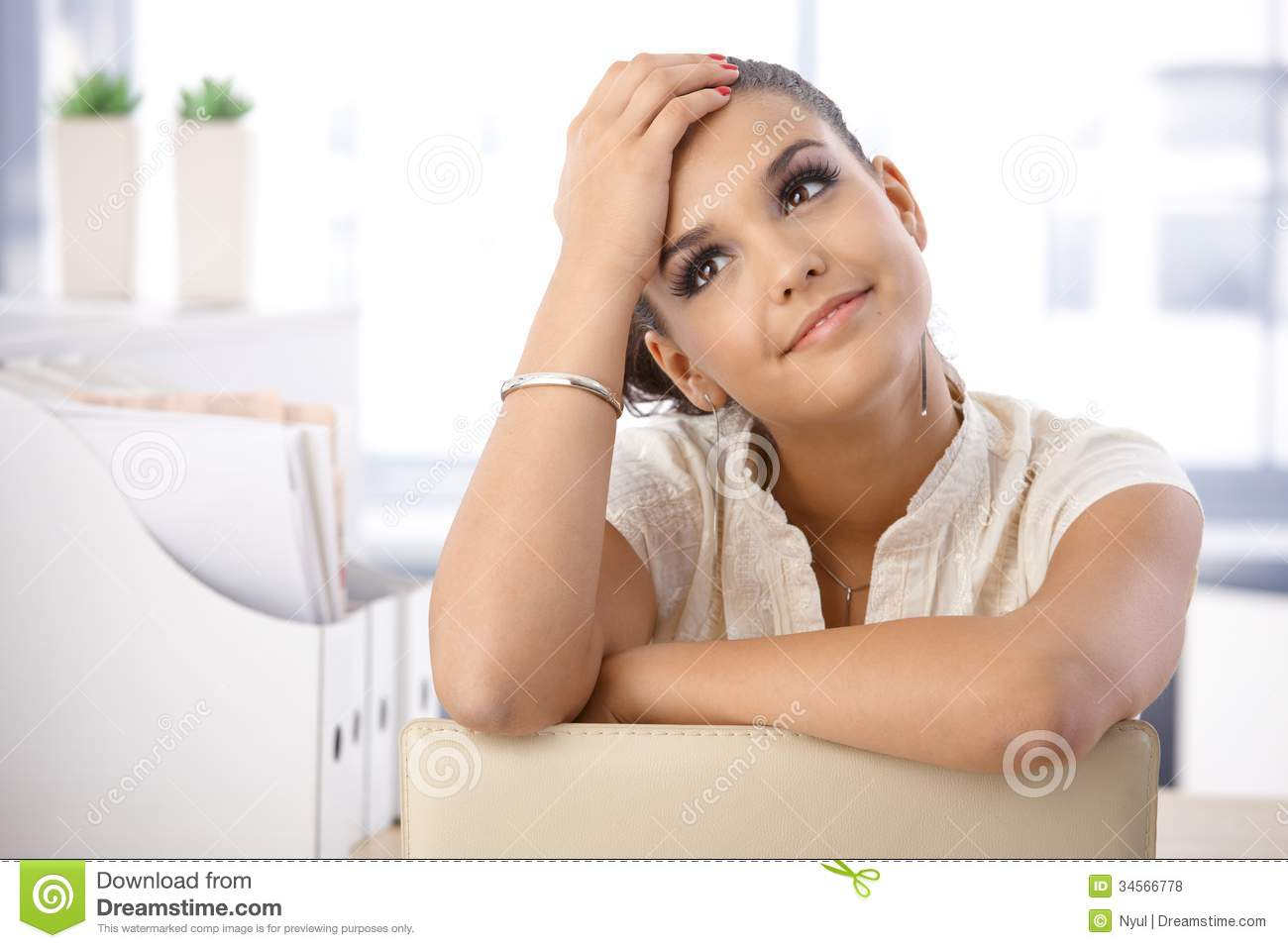 pretty woman daydreaming in office royalty free stock photos