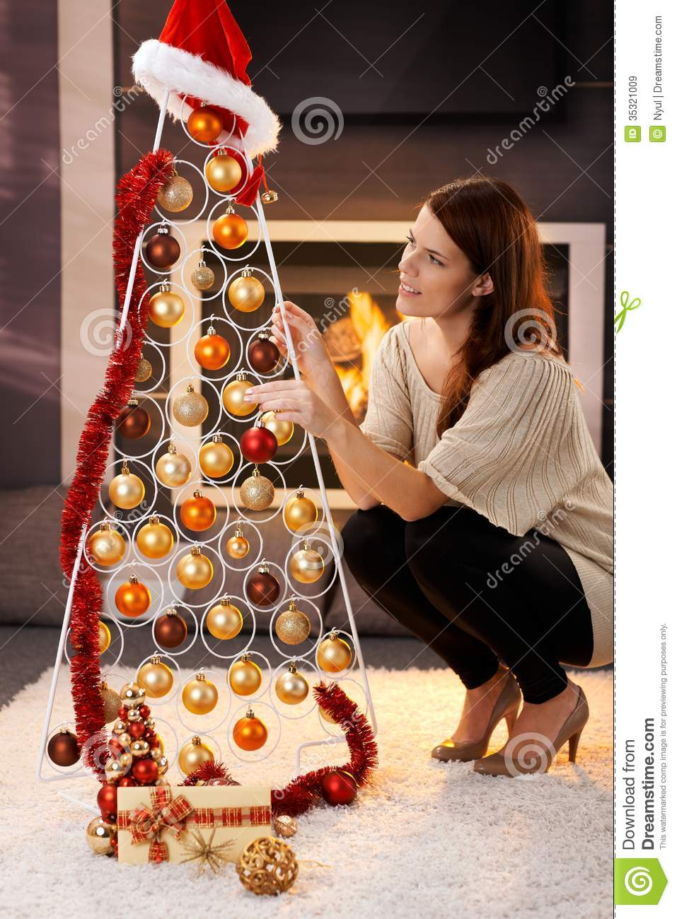 Pretty Woman Decorating Modern Christmas Tree Royalty Free Stock